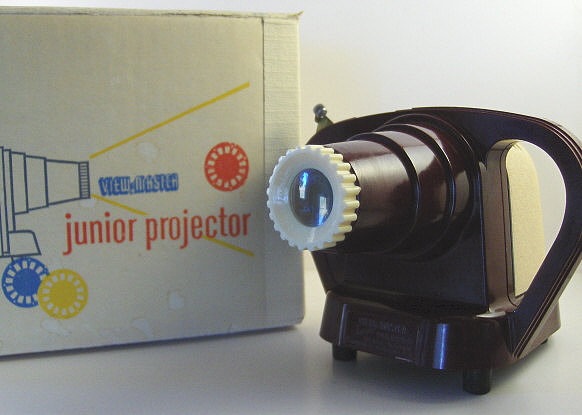 Does the sans serif font and yellow, blue, and red color scheme give away the fact that this Junior Projector is circa 1950? Source: Etsy user AnneLeesAttic