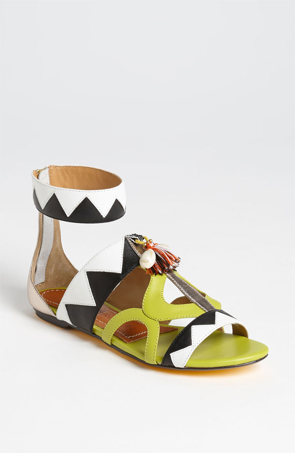 With an updated gladiator aesthetic and geometric colorblocking, these trendy Blonde Ambition sandals ($165) are like nothing you've ever seen. I can think of a million ways to work these colorful gladiators, the first pairing being an orange swing dress and crochet crossbody bag for a sunny picnic at the park. — Mandi Villa