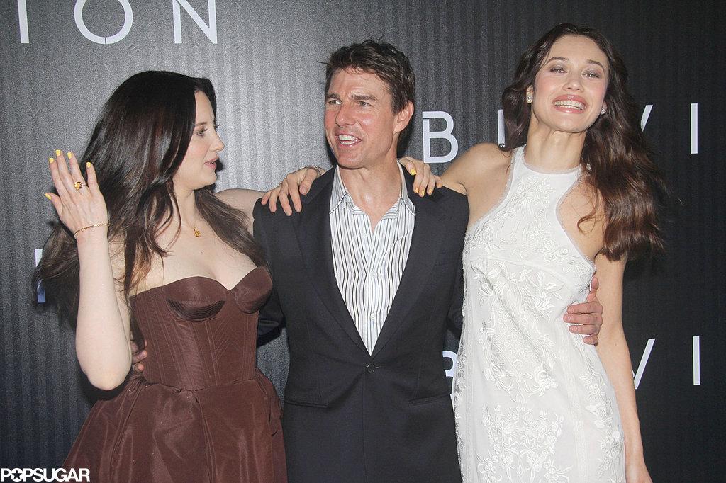 Tom Cruise posed with Andrea Riseborough and Olga Kurylenko, who wore Emilio Pucci, at their Oblivion premiere.