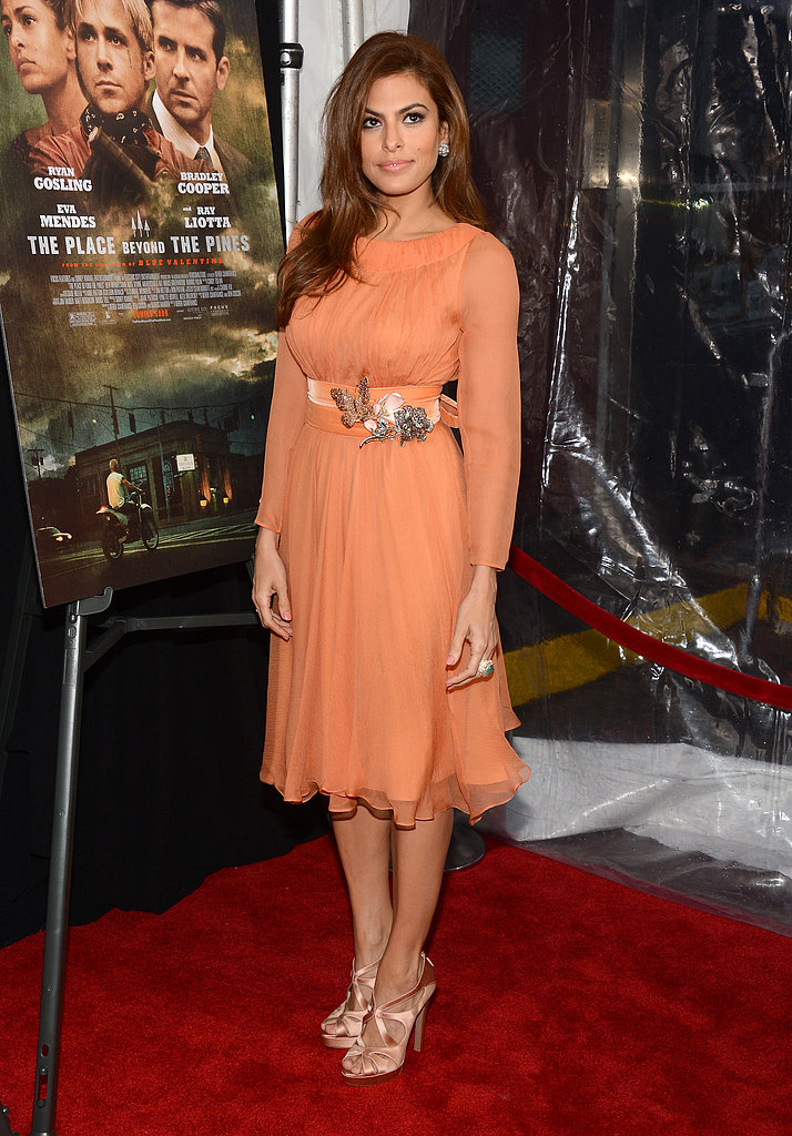 Eva Mendes wore an orange frock.