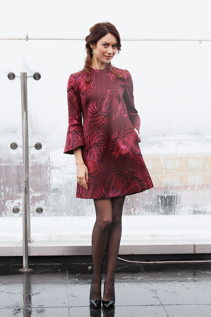 For her Oblivion photocall in Moscow, Olga went mod in a garnet Stella McCartney printed minidress with bell-shaped sleeves. She finished off with sheer black tights and black patent pumps.