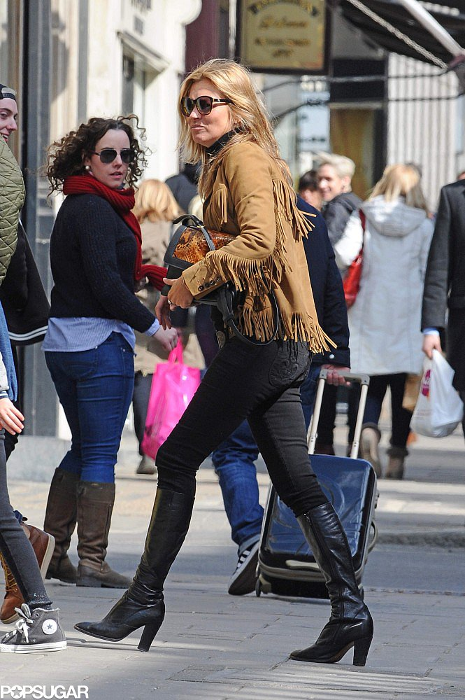 Kate Moss wore a fringed jacket to meet friends for lunch in London.