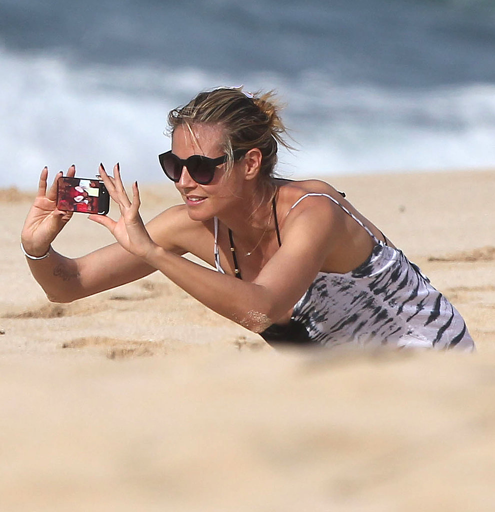 Heidi Klum snapped pictures on the beach.
