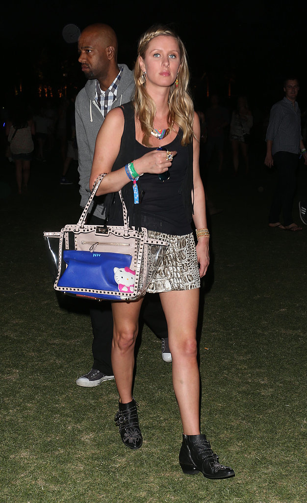 Nicky Hilton sported printed shorts with studded Chloé boots and a Valentino bag at Coachella.