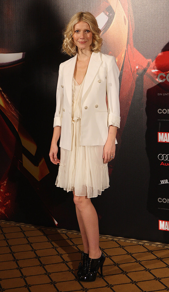 For an Iron Man photocall in Berlin, Gwyneth worked a frothy cream Stella McCartney flapper with a double-breasted blazer and patent leather oxfords.