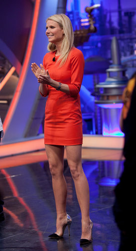 While promoting the new women's fragrance by Hugo Boss in Spain, Gwyneth wowed in an orange Boss Black mini and cap-toe Thierry Mugler pumps .