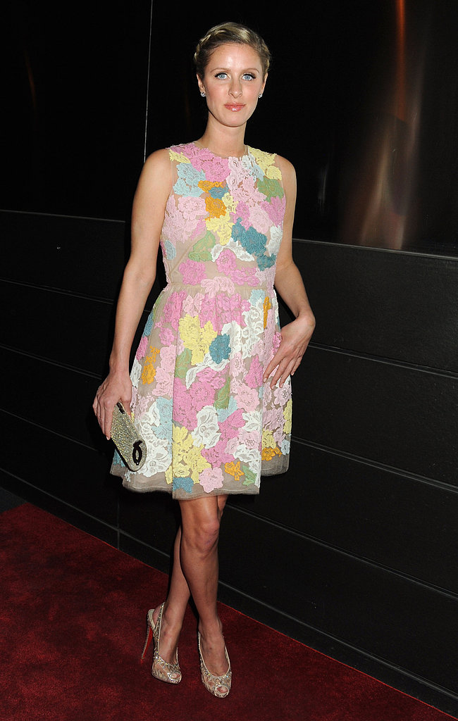 Nicky Hilton donned a colorful floral dress with peep-toe Christian Louboutin pumps at an event in NYC.