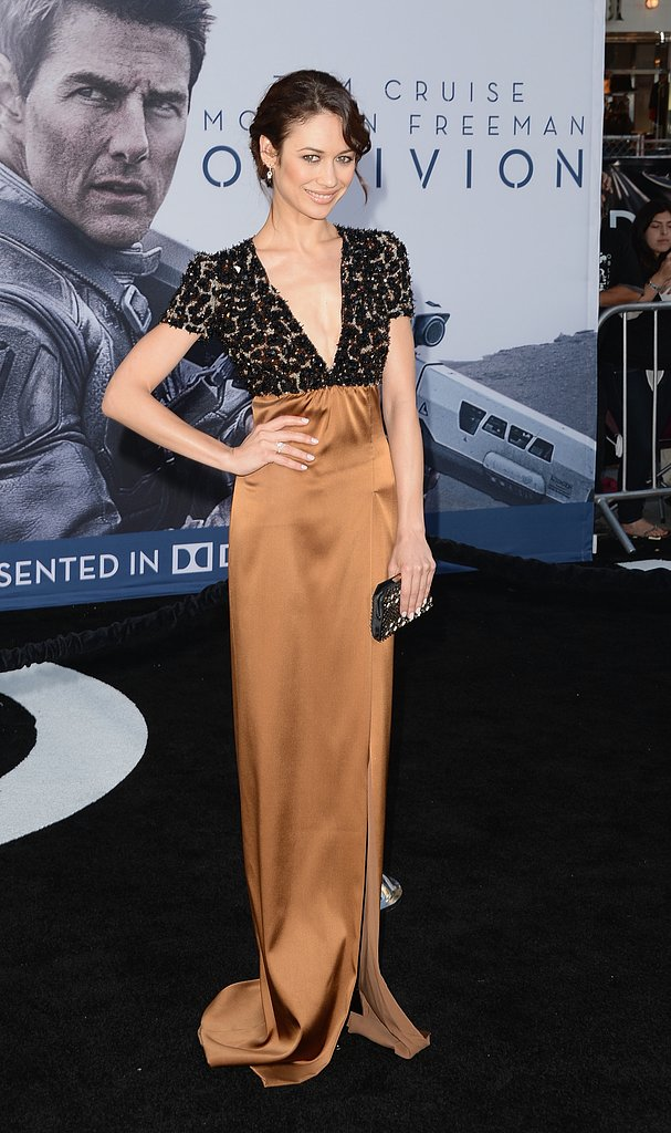 Olga Kurylenko took the plunge in a Burberry gown with a deep-V beaded bodice and a silky bronze skirt at the Hollywood premiere of Oblivion.