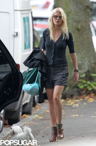 Gwyneth styled her all-blue London look with a pair of dual-textured ankle boots while dropping her kids off at school in London.
