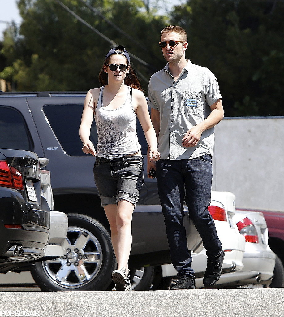 Robert Pattinson and Kristen Stewart both wore sunglasses.