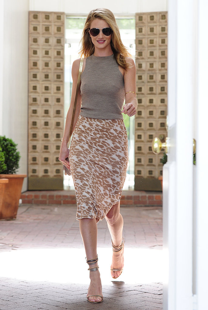 Rosie Huntington-Whiteley looked flawless from head to toe as she exited a hair salon in LA in a high-neck knit tank and a printed pencil skirt by Kain Label. Aviator sunglasses, metallic ankle-strap sandals, and a gold shoulder bag completed her warm-weather style.