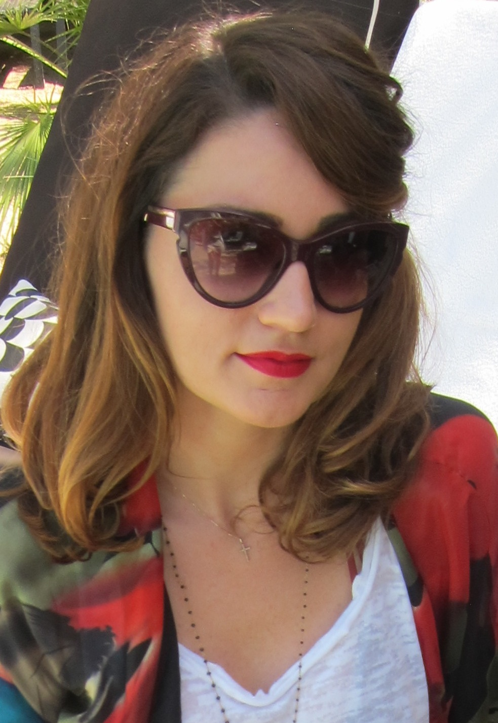 A pop of red across the lips was the cornerstone to this modern-vintage look. Photo: Meg Cuna