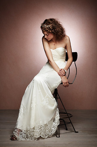 If you want lace with a hint of sexy, then this Catherine Deane ruched tulle lace gown ($1,800) is it.