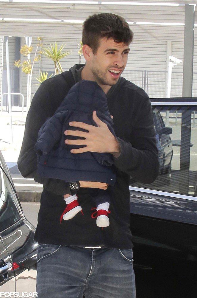 Gerard Pique carried his son, Milan, in Barcelona.