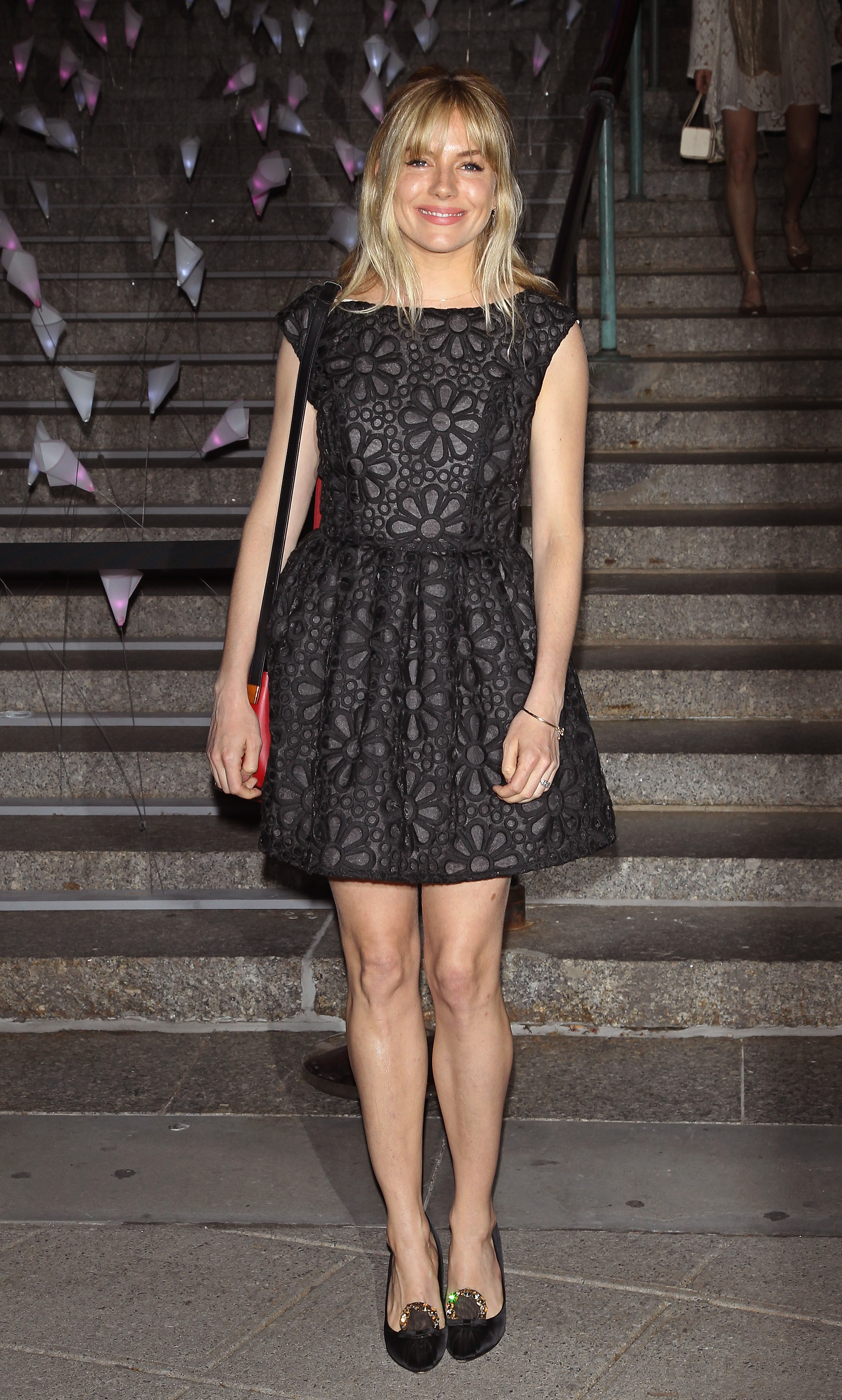Sienna Miller wore a black dress to Van
