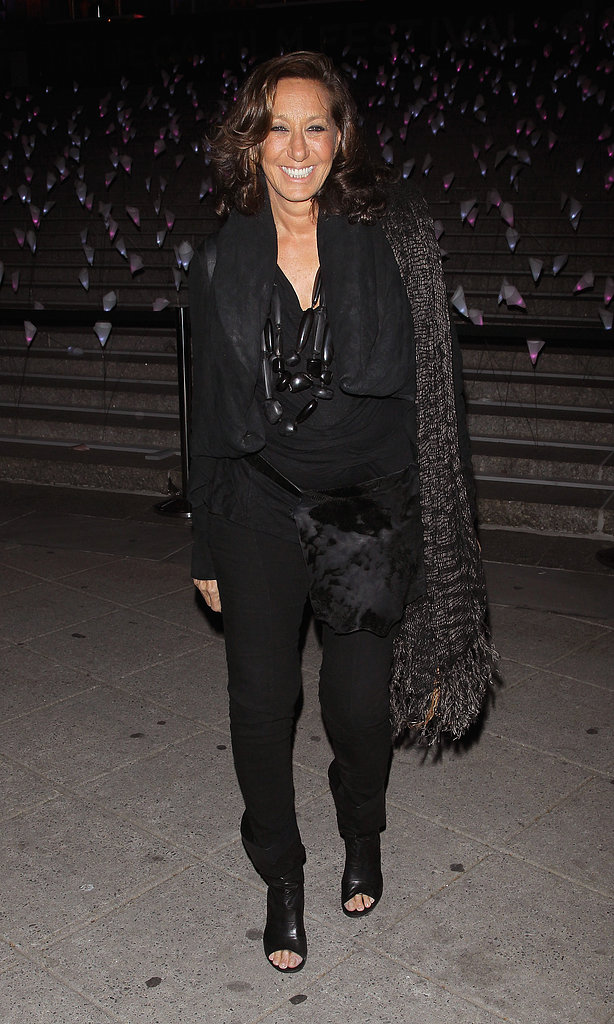 Donna Karan wore her signature head-to-toe black, and punctuated the dark ensemble with a bold stone-bead necklace and a textured scarf.