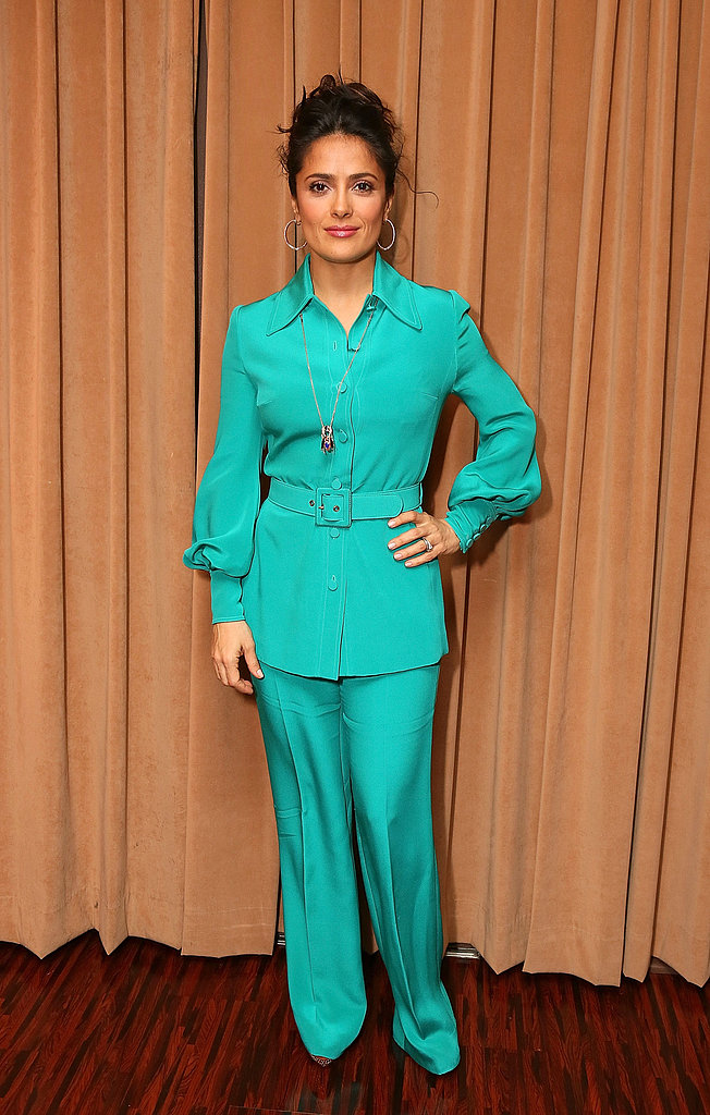 Salma Hayek donned a green Gucci suit with a long necklace and hoop earrings at CinemaCon in Las Vegas.