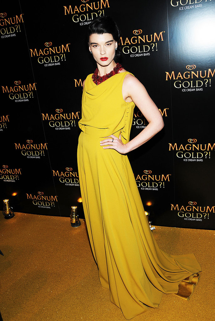 Crystal Renn lit up the Tribeca Film Festival in a chartreuse gown with rich, romantic red lips and jewels as a striking contrast.