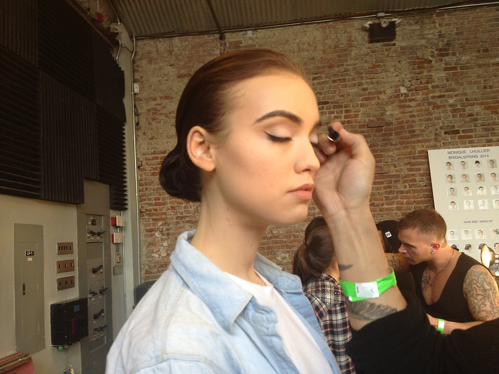 For makeup Mac Cosmetics lead artist Romero Jennings focused on the eye area. Brushed brows, sleek eyeliner, and a pale white shadow gave the look a slight '60s lilt.
