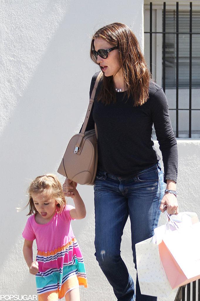 Jennifer Garner juggled shopping bags while holding Seraphina Affleck's hand in LA.