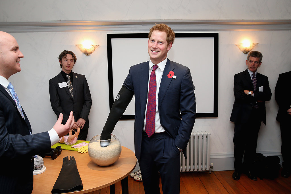 Prince Harry put his arm in a glove.