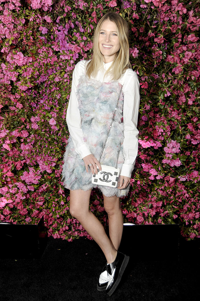 Dree Hemingway attended the Chanel dinner in a pastel Chanel dress, which she wore over a crisp white button-down, a mini Chanel bag, and two-tone oxfords.