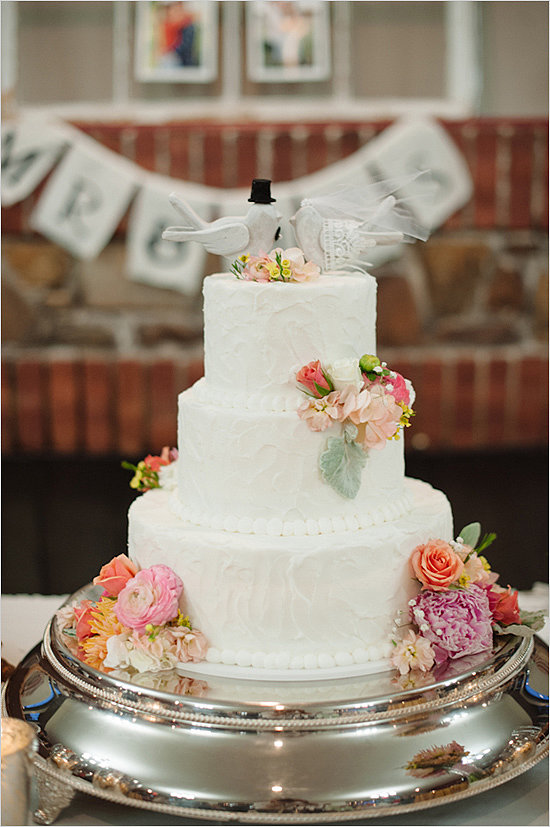 From the doves to the florals to the white beads, everything about this cake is timeless.  Photo by Brett Heidebrecht via Wedding Chicks