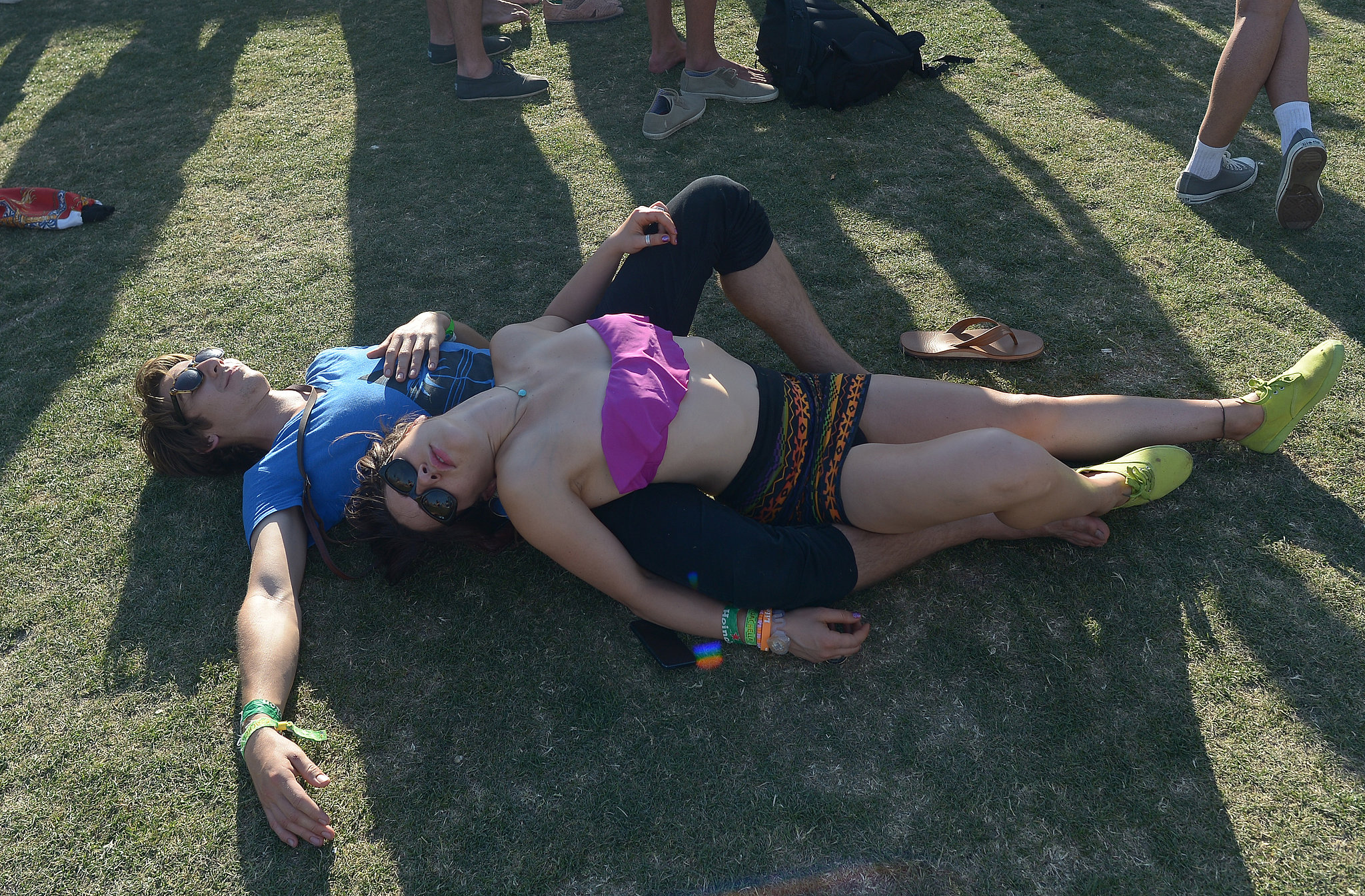 This Coachella pair relaxed together on the grass.