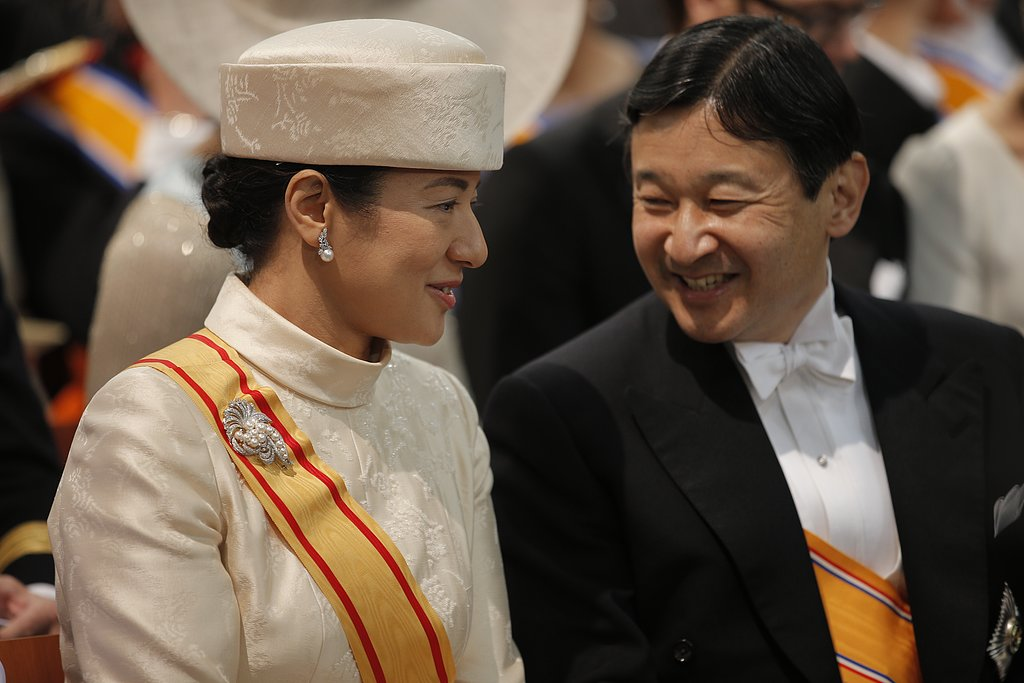 Crown Prince Naruhito and Crown Princess Masako of Japan chatted in their seats.