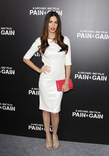 Paz Vega shimmered in her white metallic dress at the Pain & Gain premiere in LA. A red quilted clutch, matching lips, and nude peep-toes added a hint of color.