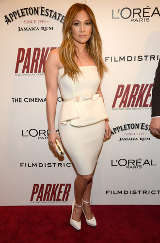 Jennifer Lopez was a vision of posh in a white peplum dress and white ankle-strap pumps, both by Lanvin, at the NYC screening of Parker.