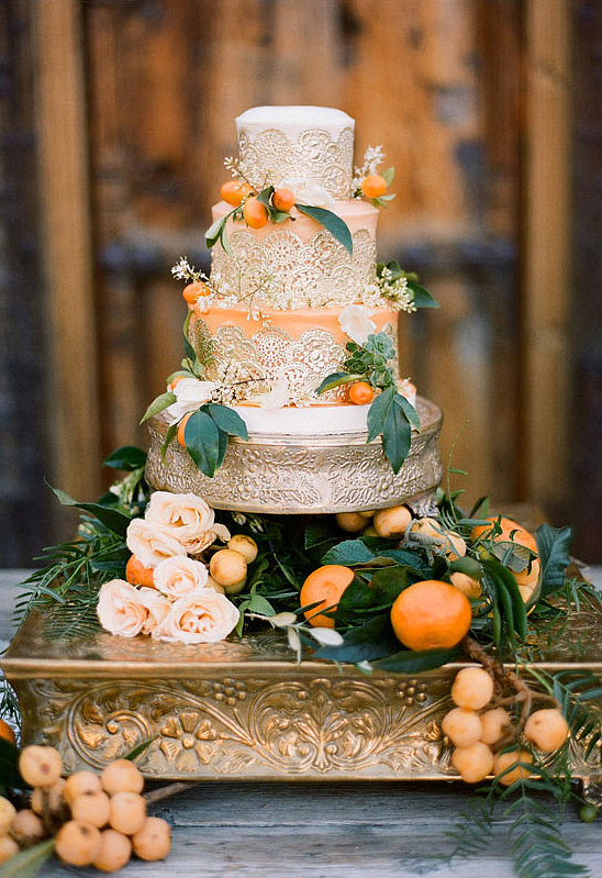 This is one occasion where there's no such thing as too much pomp and circumstance. The lace! The gold! The oranges! It's all fit for a royal wedding, if you ask us.  Photo by Stephanie Williams of This Modern Romance  via 100 Layer Cake