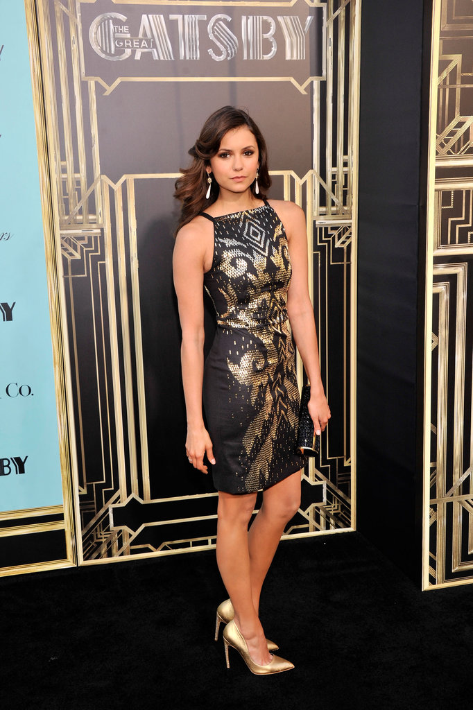 Nina Dobrev opted for a sexier number in a Versace dress featuring gold detailing. The actress completed her ensemble with gold Rupert Sanderson pumps and statement drop earrings.
