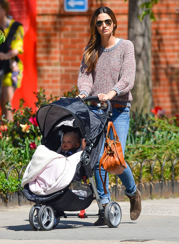 Lily Aldridge looked cool in a knit Étoile Isabel Marant sweater, brown suede boots, and Ray-Ban aviators while on mommy duty in NYC.
