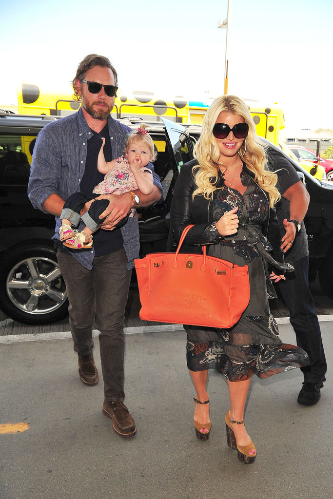 Jessica Simpson arrived at LAX with her fiancé, Eric Johnson, and their daughter, Maxwell.