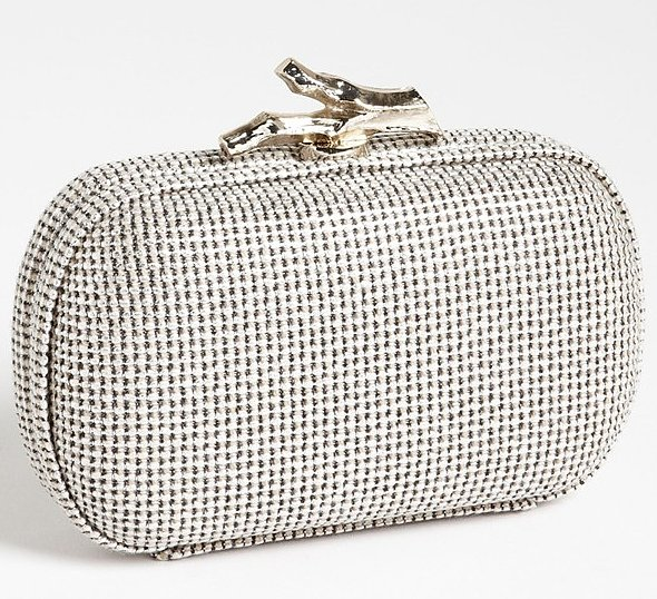 Diane von Furstenberg's woven metallic clutch ($297) is a great shape, and the clasp closure provides a unique touch.