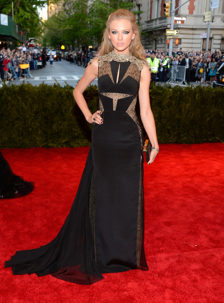 Taylor Swift exuded dark glamour in a black J. Mendel gown with lace insets and Lorraine Schwartz baubles.