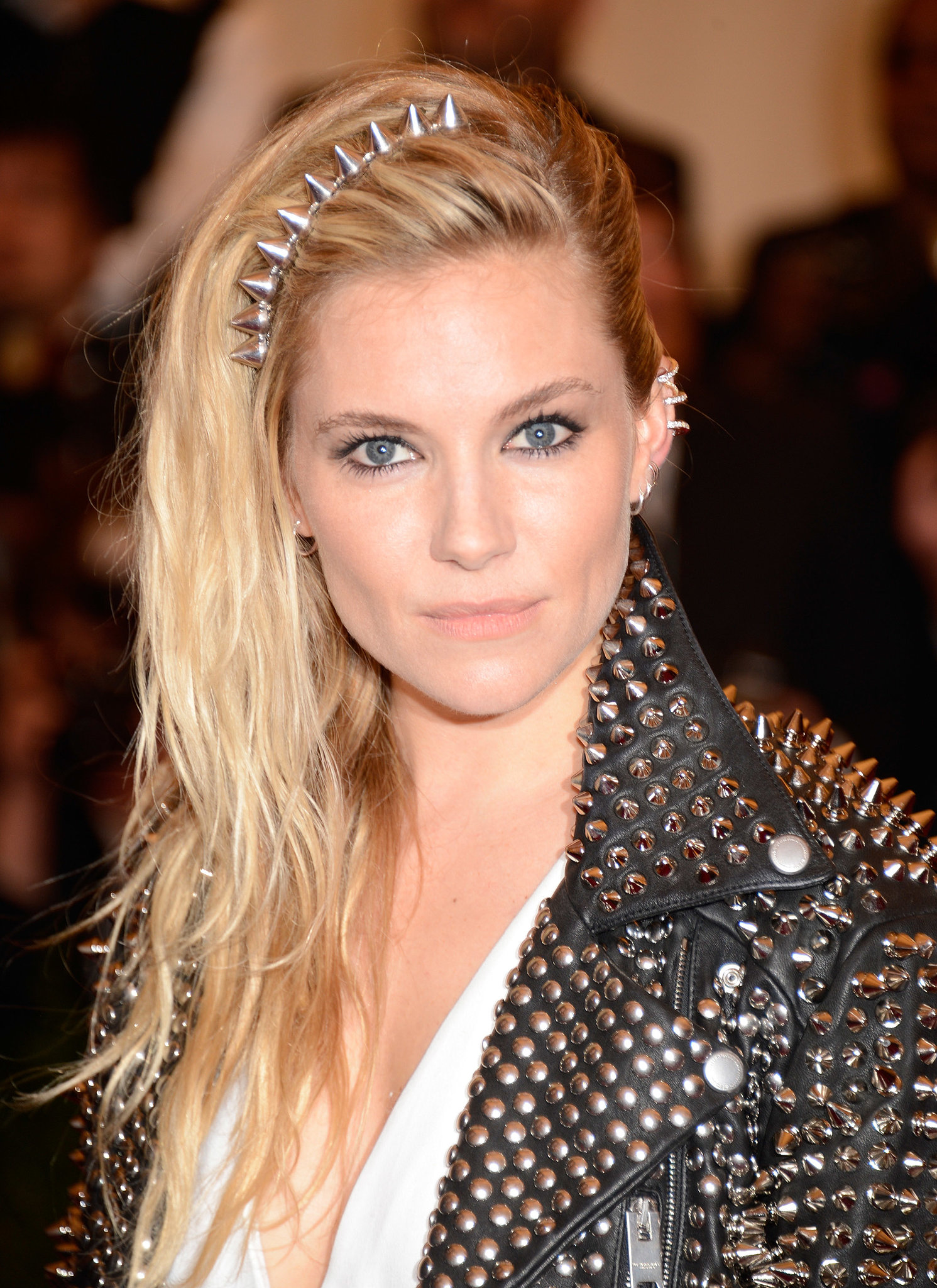 Sienna Miller's bedhead beach waves were beautifully embellished with a spiked headband.