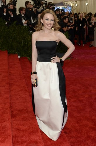 Kylie Minogue took the black and white direction in a strapless Moschino gown.