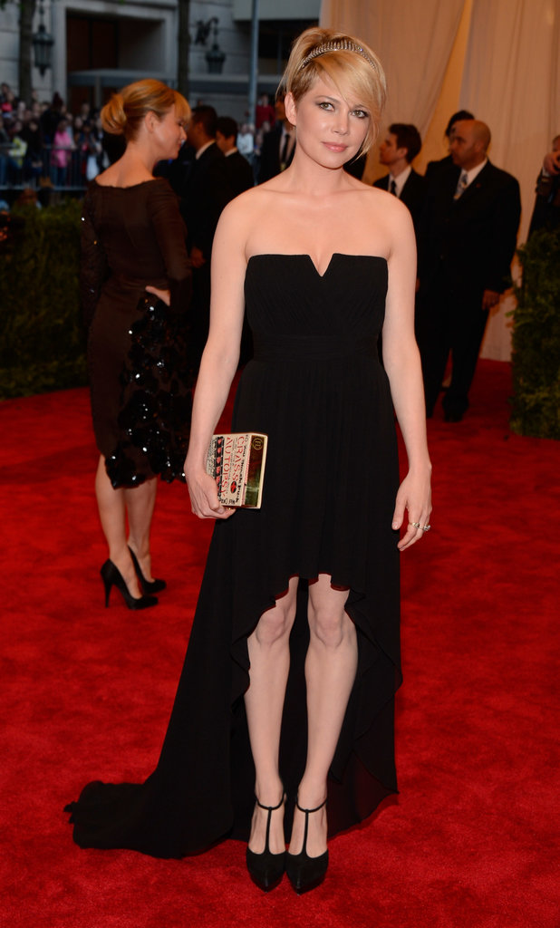 Michelle Williams was understated in a black strapless Saint Laurent high-low gown with a book clutch and T-strap pumps. She worked the punk princess angle just enough with her Fred Leighton antique diamond tiara.