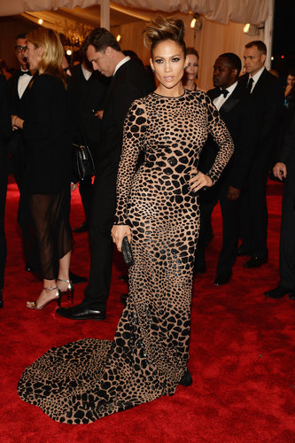Jennifer Lopez's custom black leopard, sequin-embroidered Michael Kors gown was a lesson in formfitting tailoring. She added a Christian Louboutin clutch and Dana Rebecca earrings to boot.