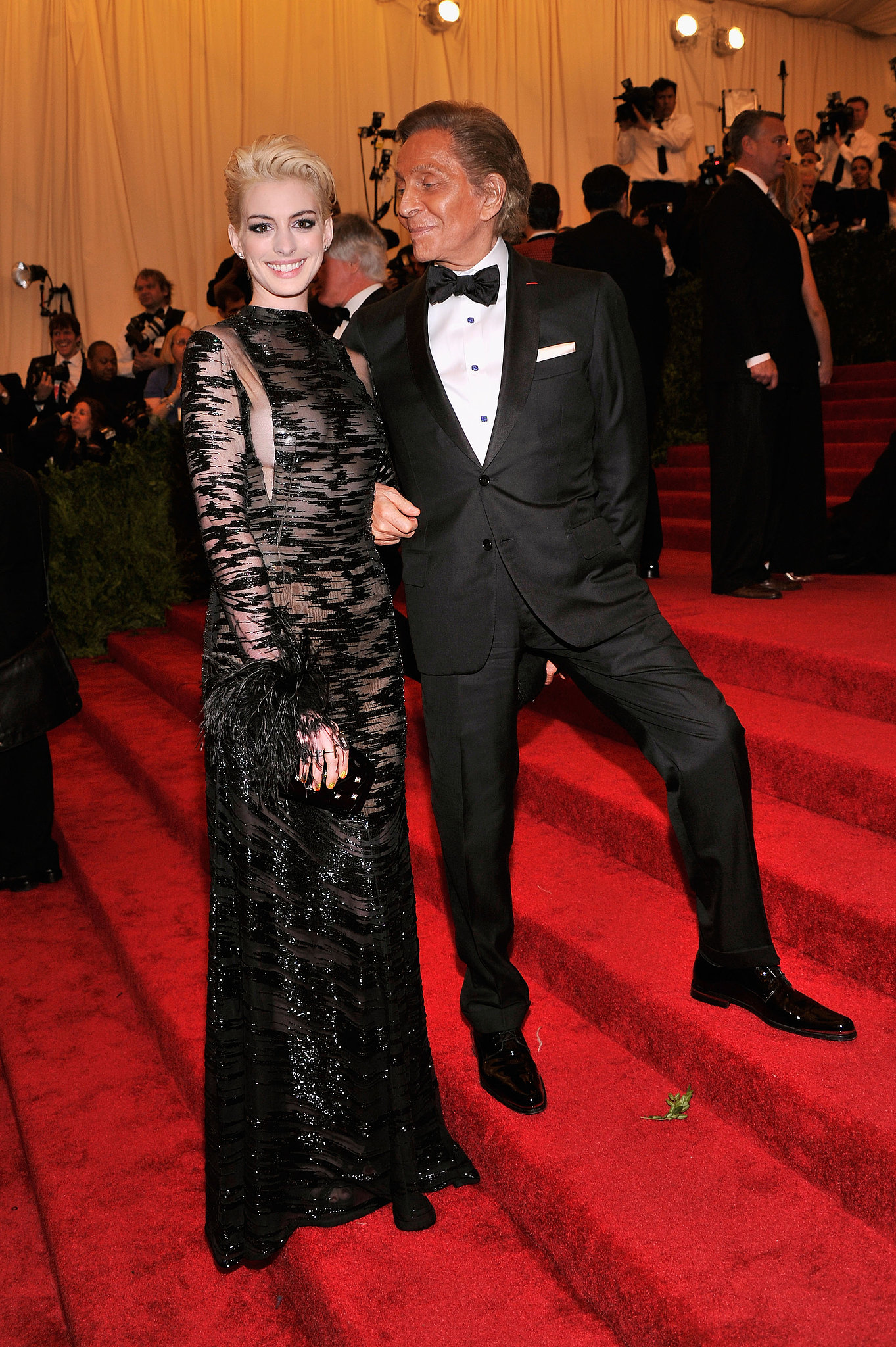 Anne Hathaway had Valentino's help navigating the steps.