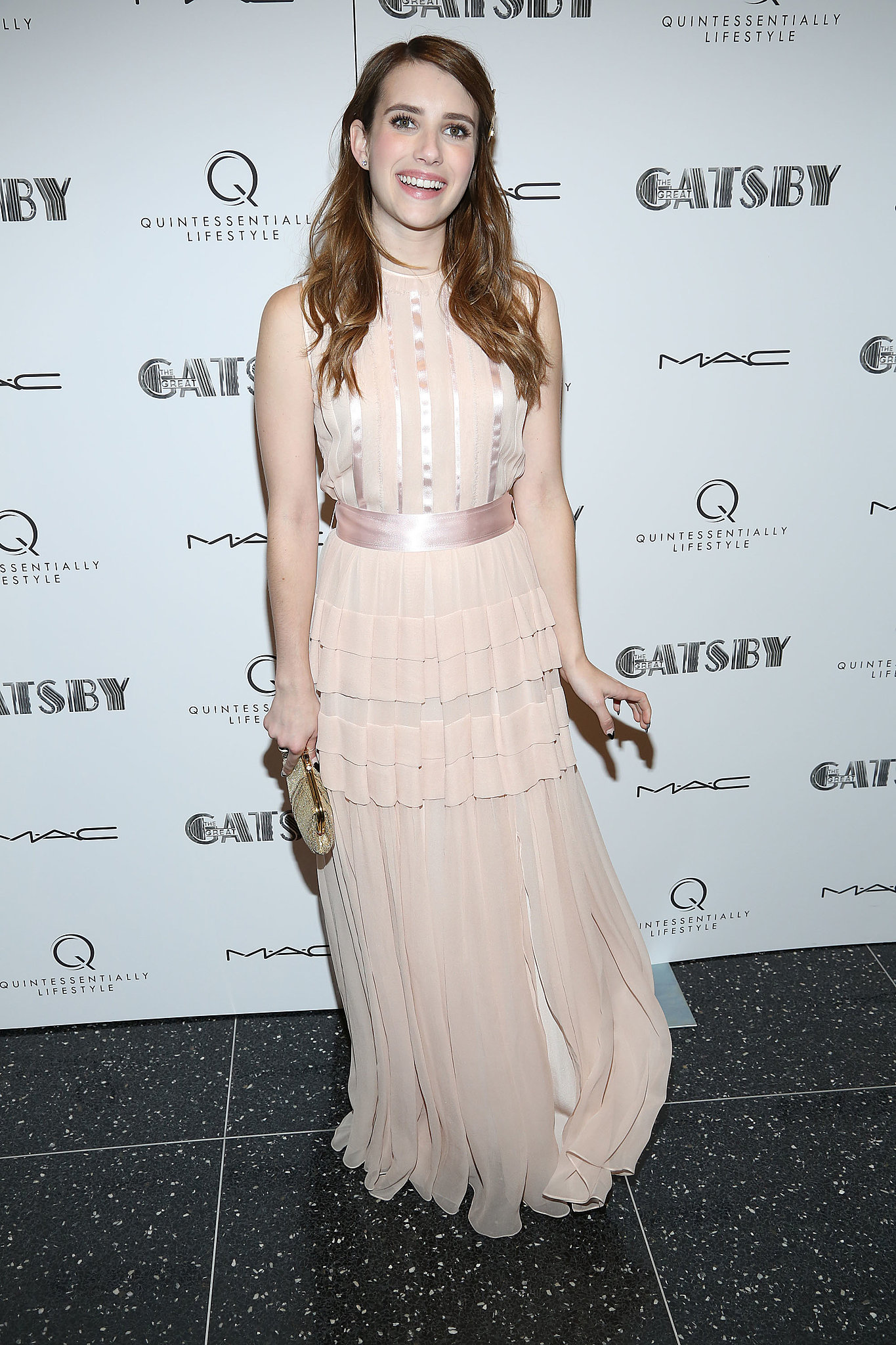 Emma Roberts attended the pre-Met Gala screening of The Great Gatsby in an ultrafemme, petal-pink Jonathan Saunders confection, adorned with a satin ribbon at the waist.