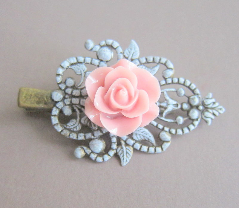 This vintage-style hair clip ($10) adds the perfect hint of blue and a pop of pink to your bridal hair look.