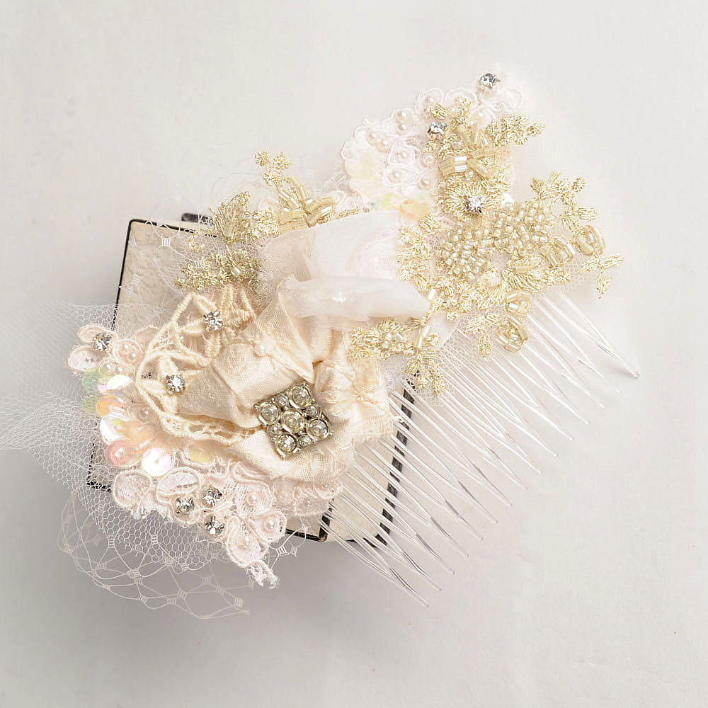 Skip the rhinestones for a pretty beaded lace hair comb ($75) instead.