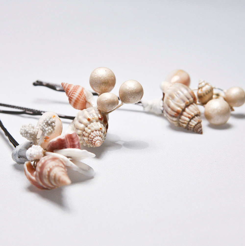 The beach bride could add seashell bobby pins ($25) to her cascading waves.