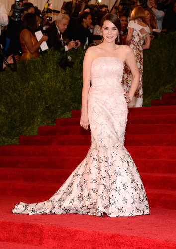 Bee Shaffer posed in a soft pink strapless Christian Dior gown with contrasting black and pink beading.