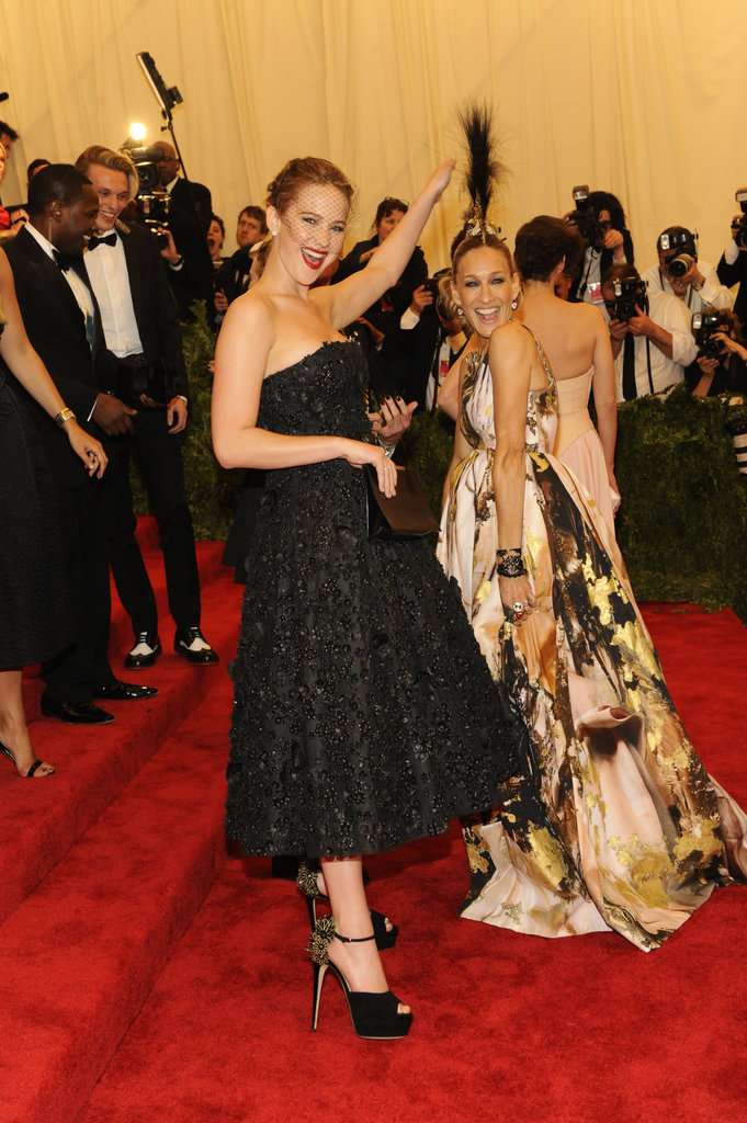 Jennifer Lawrence got playful with Sarah Jessica Parker's mohawk headpiece.