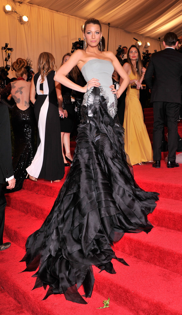 Blake Lively worked her Gucci gown as she made her way up the stairs.