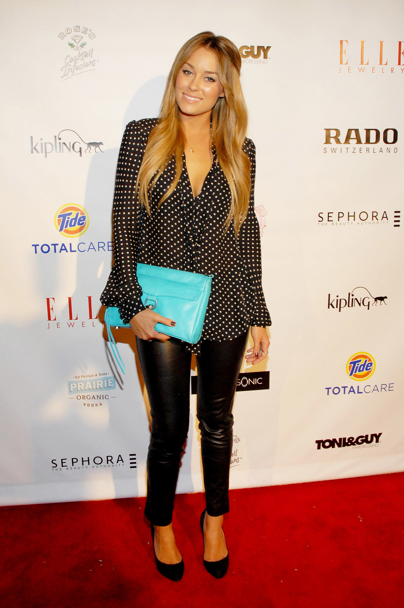 Lauren hit the town in polka dots and liquid leather in 2009 — we love the bright blue clutch! Lesson from Lauren: sometimes it's all about the accessories.